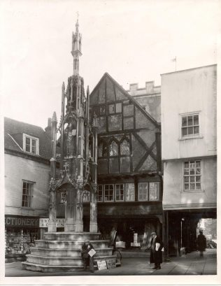 Butter Cross, Winchester, with the Tyrrell and Green branch situated just behind it