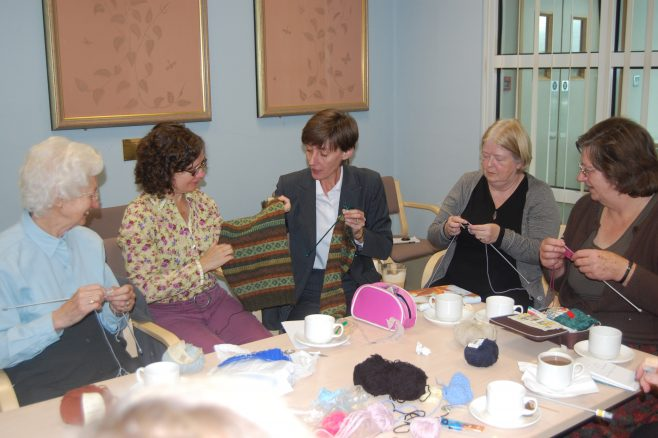 Chris Lennon (centre) and Rosalind Campbell (Rowan) with members of the Crochet and Knitting Club | Chronicle, Watford