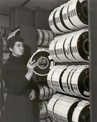 A Partner with some electro-magnetic tape, essential equipment for the early computer, c1970s