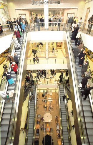Customers crowd the elevators of the brand new John Lewis Cribbs Causeway