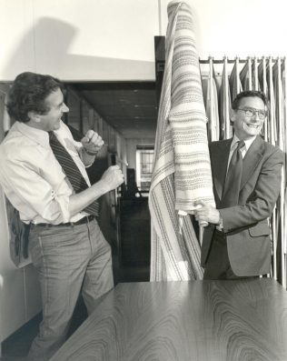 Cavendish Textiles Production Manager Harry Davy (left) sharing a joke with Partnership buyer Mr J Cross