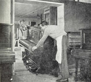 An old piano is taken into the workroom for reconditioning | The Gazette of the John Lewis Partnership 4th May 1957