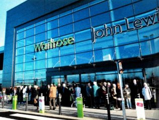 Customers queue for the delights held within John Lewis and Waitrose