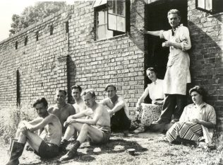 John Bew (standing) and his staff, circa 1950