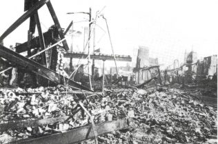 A photograph depicting the smouldering remains of Knight and Lee, 1941