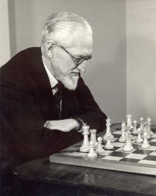 John Spedan Lewis at the chess board, 1959