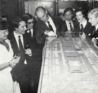 The Partnership Chairman deliberates over a model of the Milton Keynes shopping centre