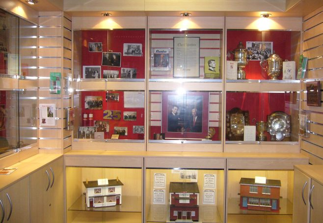 Display cabinets with memorabilia including models of the houses. | From the private collection of J.Spence