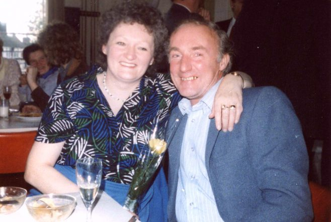 Laura Mitchell with her husband Terry and the yellow rose. | From the private collection of Laura Mitchell
