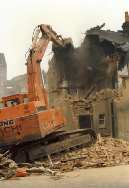 Demolition begins on the cottages. | JLP Archive Collection.