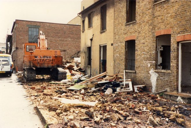 The Cottages between the shop and the Kinghams warehouse awaiting demolition. | JLP Archive Collection.