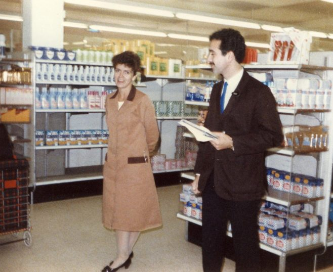 Sue Hitchcock (office manager) with Leo ? (grocery manager). | From the private collection of Laura Mitchell