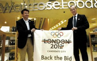 Then Partnership chairman Sir Stuart Hampson, and London 2012 Chairman Sebastian Coe hold between them a 'Back the Bid' banner, a physical embodiment of the Partnership's commitment to the London 2012 bid.