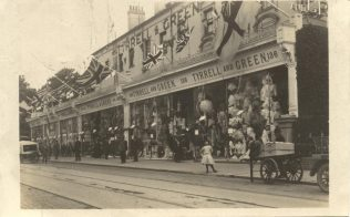 The exterior of Tyrrell and Green from 1911, decorated for the coronation of King George V