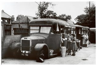 A picture from 1942 showing Bonds operating out of a fleet of buses