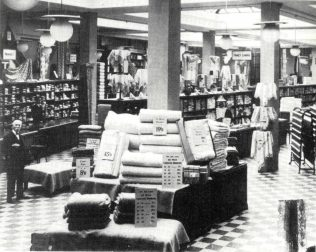 A photo of the interior of Jessops, with Mr Dickinson standing on the far left hand side. Taken in the early 1930's, Mr Dickinson was at this point 84 years old