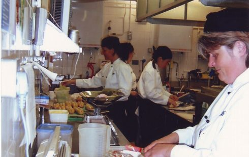 Preparing dishes in food preparation area kitchen Robert Sayle