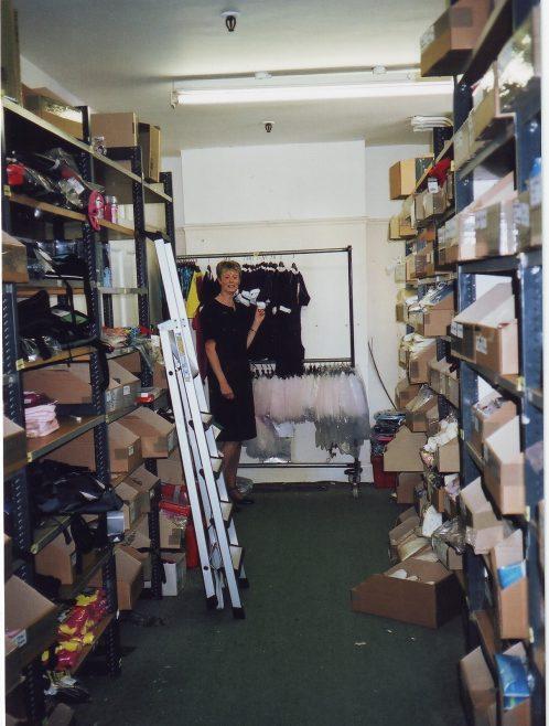 Wendy Butler in the Robert Sayle Childrens Wear stockroom