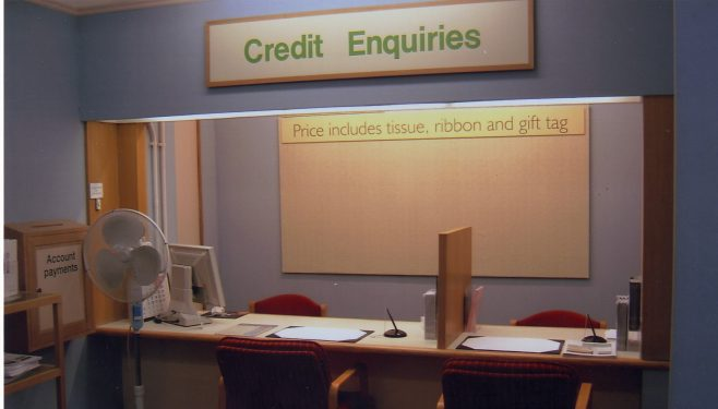 Robert Sayle Credit desk being used as a gift wrapping area at Christmas 2003