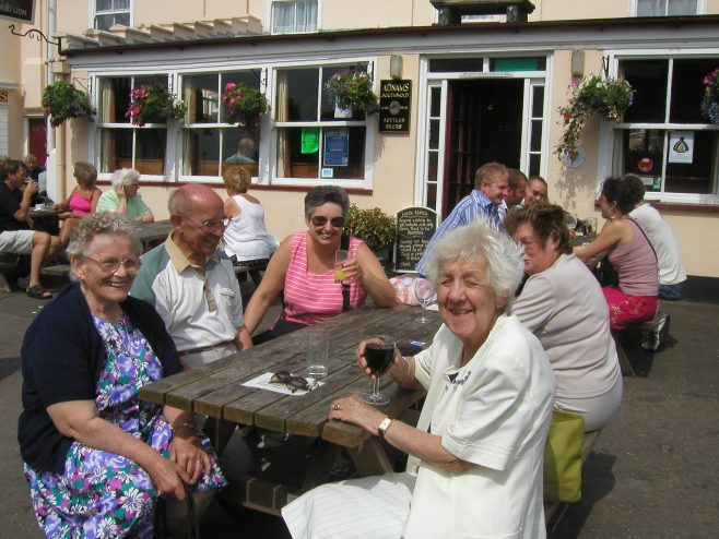 Robert Sayle Retired Partner's outing to Southwold. Enjoying some refreshment.