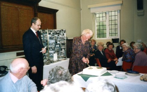 Lorna Howard cutting the cake at the Diamond Birthday Tea