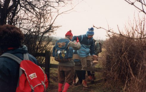 Robert Sayle Rambling Club members climb a stile on their first walk Toft to Bourn. 15th March 1987
