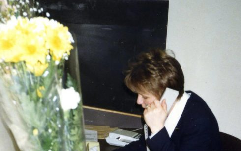 Pam Bodger with her birthday flowers in the Robert Sayle Cash Office