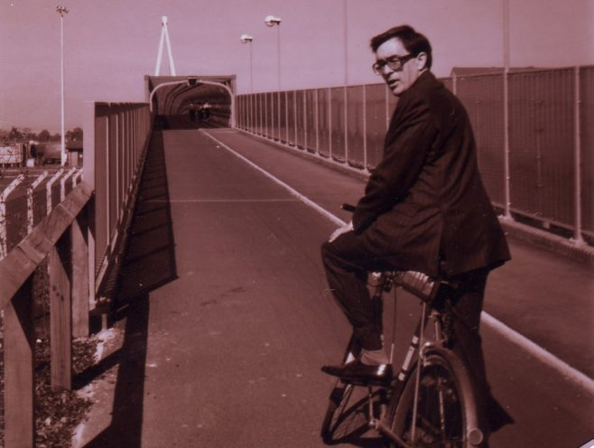 John Tomes on the Robert Sayle bicycle on the new cycle bridge on his way to the Magnet Service building