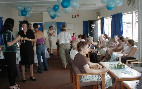 Guests enjoying Linda Cox's retirement party.