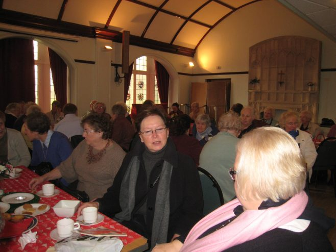 Retired Partners enjoy Christmas coffee morning together.