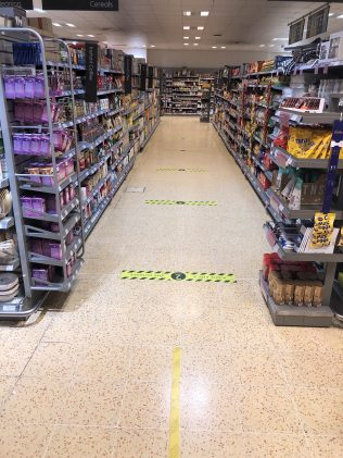 Floor markings reminding customers to socially distance from each other. | Jake Townsend - ATM Buckingham