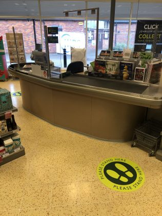 Safe distance reminder stickers on the floor and perspex screens at the checkout to enable both our customers and cashiers to interact safely. | Jake Townsend - ATM Buckingham