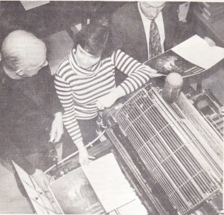 Printer Bob Collier is on the left and Printing Office Manager Tom Lunn on the right, with Mrs Ann Stock the Section Manager in charge of our offset machinery.