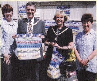 Customer Service Assistant Jackie Craigie, who also helped on the day, with the Mayor and Mayoress of Peterborough and Supermarket Assistant Jenny Dwight.