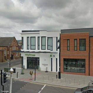 This view shows the corner aspect of the new branch | Store Planning Photo Library