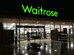A night time view of Little Waitrose Faringdon customer entrance | Store Planning Photo Library