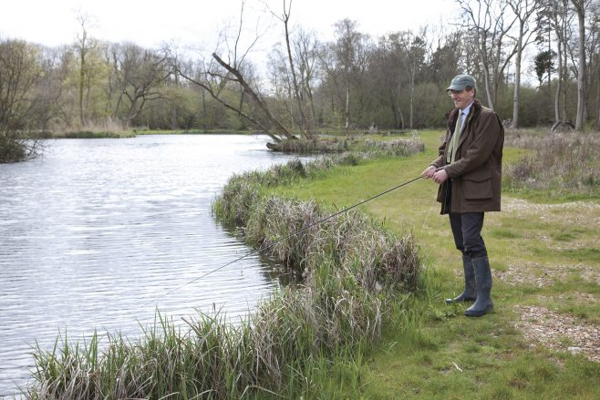 Partnership Chairman Charlie Mayfield fishes at the new lake | Connections/Waitrose Chronicle