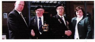 Right: Branch Manager Kevin Gilby, outside the branch with two veterans and Sarah Parker branch Admin Manager