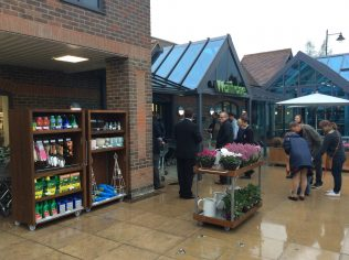 A wet view of the Little Waitrose Hawkhurst customer entrance | Store Planning Photo Library