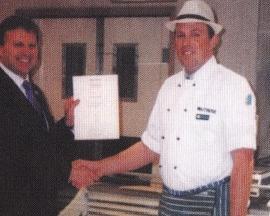 Managing Director presents certificate