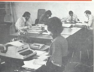The Merchandising Department moved to a more spacious office on the ground floor replacing the Print Room from the 1st floor in February 1977. From the left is Mike Myers from the Field Projects team, Jeanette Drysdale who managed the publication of the Daily Bulletin, Derek Strange Manager Layouts, Terry Hammond Assistant Manager Layouts and Janet Brant Admin Assistant | Waitrose Chronicle