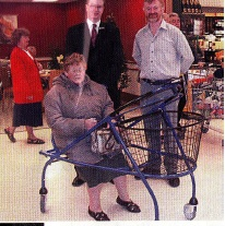 DM Andrew Downie, Mark Duff inventor and customer Mrs Patterson with a trolley